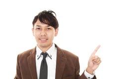 asiatiskt le för affärsman royaltyfri bild