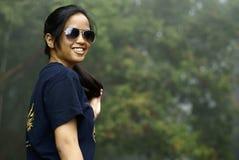 asiatiskt le för malay som är teen royaltyfri fotografi