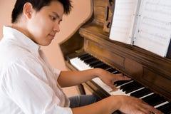 asiatiskt leka för piano Arkivfoto