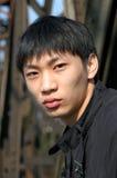 asiatiskt manbarn Arkivfoto