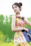 asiatiskt model utomhus- posera Royaltyfria Bilder
