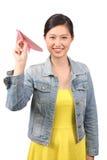 Asiatiskt pappersflygplan för kvinnlig student - serie 2 Royaltyfria Bilder