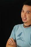 asiatiskt skratta för grabb Arkivbilder