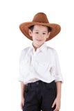 asiatiskt slitage för pojkecowboyhatt Arkivbilder
