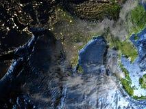 Asie du Sud-Est sur terre la nuit - fond océanique évident Photos stock