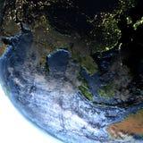 Asie du Sud-Est sur terre la nuit - fond océanique évident Photos libres de droits