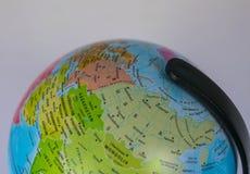Asien översikt på ett jordklot med vit bakgrund Royaltyfri Bild