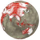 Asien auf Backsteinmauer Erde Lizenzfreie Stockfotografie