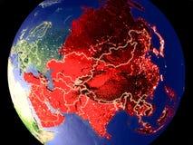 Asien auf Erde nachts lizenzfreies stockfoto