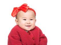 Asien behandla som ett barn leende Arkivfoto