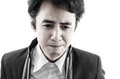 Asien-Mann in traurigem. Lizenzfreie Stockbilder