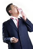 Asien-reicher Mann küßt Geld Stockbild