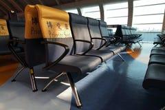 Asiento de la prioridad en aeropuerto Foto de archivo libre de regalías