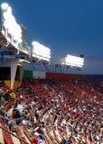 Asiento del estadio en el partido nocturno Imágenes de archivo libres de regalías