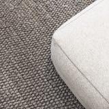 Asiento suave en la alfombra gris Imágenes de archivo libres de regalías