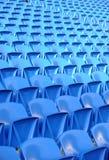 Asientos azules en estadio Fotografía de archivo