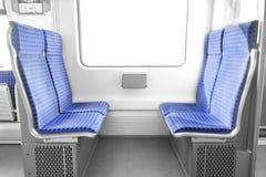 Asientos de un tren urbano Imagenes de archivo