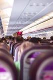 Asientos del avión con los pasajeros Foto de archivo libre de regalías