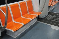 Asientos del carro del metro Imágenes de archivo libres de regalías