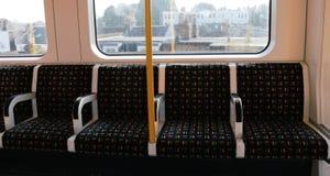 Asientos del tren en Londres Fotografía de archivo
