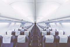 Asientos modernos del aeroplano en perspectiva Concepto del transporte ai Imagen de archivo libre de regalías