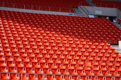 Asientos rojos del estadio Foto de archivo libre de regalías