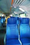 Asientos vacantes dentro de un tren italiano Imagen de archivo libre de regalías