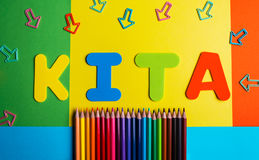 Asilo Kindergarten pencil color arrow background. Textn stock image