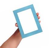 Asimiento azul del marco Fotos de archivo libres de regalías