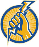 Asimiento de la mano un tornillo de relámpago de la electricidad Foto de archivo
