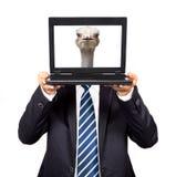 Asimiento del hombre de negocios el ordenador Imagen de archivo libre de regalías