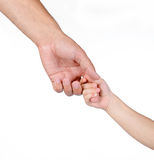 Asimiento del niño la mano del padre Foto de archivo libre de regalías