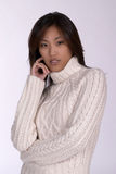 Asin woman in winter sweater. Sexy Asian woman in winter sweater Royalty Free Stock Image