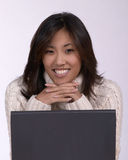 Asina woman at computer Royalty Free Stock Image