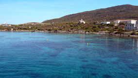 Asinara island in Sardinia, arrival in ferry. Intense blue sea water. Buildings in nature park. Royalty Free Stock Photos