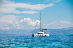 Asingle catamaran in the open sea.Sailboat in the Mediterranean Sea.catamaran sailing boat near coast.catamaran sail royalty free stock images