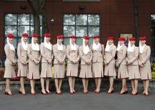 Asistentes de vuelo de la línea aérea de los emiratos en Billie Jean King National Tennis Center durante el US Open 2013 Fotos de archivo libres de regalías