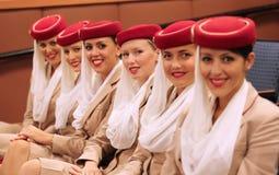 Asistentes de vuelo de la línea aérea de los emiratos en Billie Jean King National Tennis Center durante el US Open 2013 Imagenes de archivo