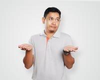 Asiático joven divertido Guy Showing Unhappy Face Imagenes de archivo