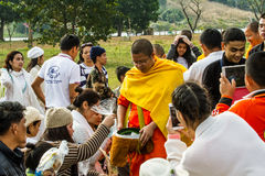 Ask for alms. Chiang rai,Thailand-January 1,2015 : V. Vajiramedhi leading monks and novices ask for alms from buddhism in Rai Cherntawan meditation center. V royalty free stock photography
