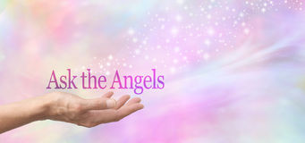 Ask the Angels for Help. Female hand face up with the words Ask the Angels floating above on a misty pastel bokeh background and a stream of sparkles flowing Royalty Free Stock Photo