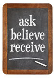 Ask, believe, receive on blackboard royalty free stock photos
