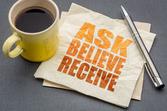 Ask, believe, receive concept on napkin royalty free stock photos