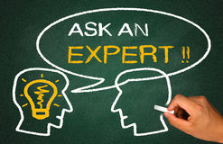 Ask an expert. Concept on chlkboard Stock Image