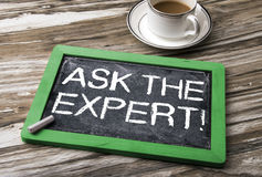 Ask the expert concept. Ask the expert handwritten on blackboard Royalty Free Stock Image