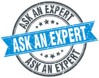 Ask an expert round grunge stamp Royalty Free Stock Photography