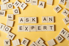 Ask an EXPERT text on wooden cubes. Wood abc. Ask an EXPERT text on wooden cubes. Wood abc Royalty Free Stock Photography