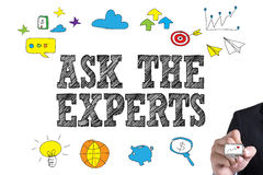 ASK THE EXPERTS. Businessman hand writing with black marker on white background Royalty Free Stock Photo