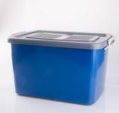 ask för ask- eller plast-lagringsbehållare på bakgrund Fotografering för Bildbyråer
