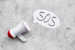 Ask for help concept. Megaphone near cloud with word SOS on grey background top view copy space. Ask for help concept. Megaphone near cloud with word SOS on grey royalty free stock photos
